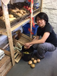 Volunteer Yien, in the shop at Elm Tree Farm