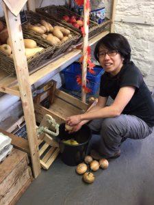 Volunteer Yien, in the shop at Elm Tree Farm