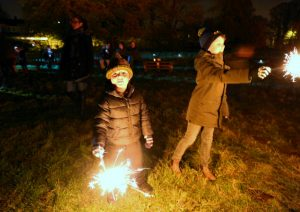 Children having fun with sparklers at Elm Tree Farm Bonfire Night party